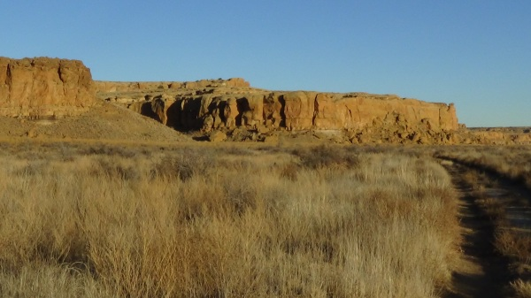 """Image: """"Chaco Canyon National Historical Park, New Mexico 16,"""" by Alice B. Clagett, 3 December 2015, CC BY-SA 4.0, from """"Awakening with Planet Earth,"""" https://awakeningwithplanetearth.com .."""
