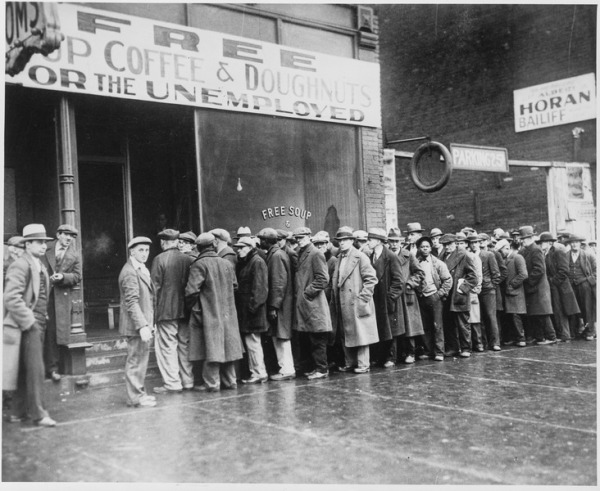 lossy-page1-732px-Unemployed_men_queued_outside_a_depression_soup_kitchen_opened_in_Chicago_by_Al_Capone,_02-1931_-_NARA_-_541927.tif